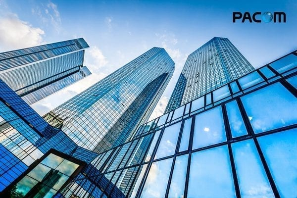 image of buildings with PACOM logo on