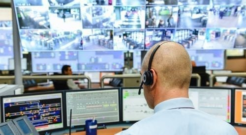 person sitting in Control room | Remote Managed Security System