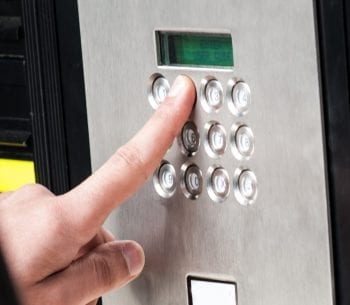man entering security code to one of our alarm keypads