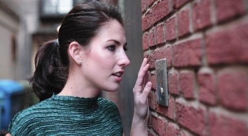 women speaking into an intercom | intercom systems